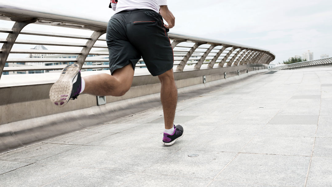 Man running over the bridge